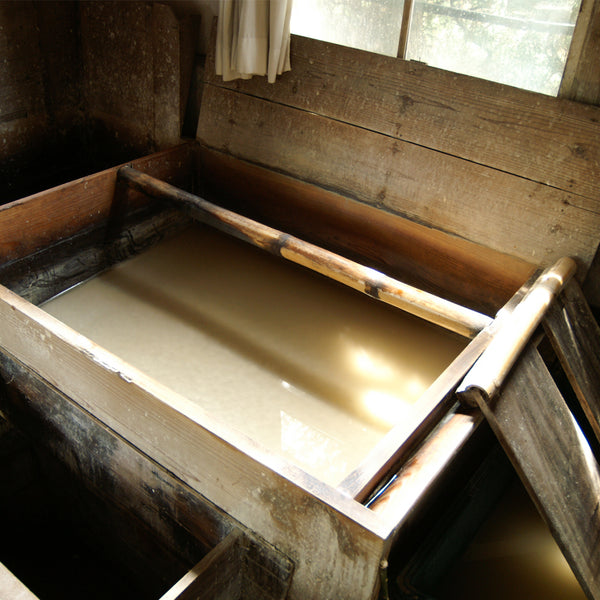 Washi bath of toroso, kozo fibres and pure ice cold water to make the best Japanese paper
