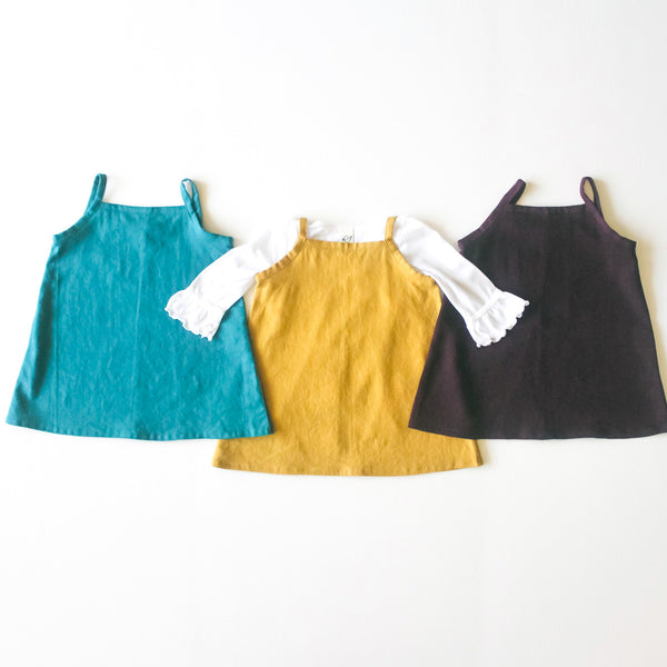 Three dress layout in Deep Teal, Rust and Purple.