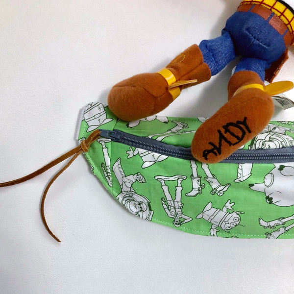 Fanny Pack in green fabric with Toy figures.