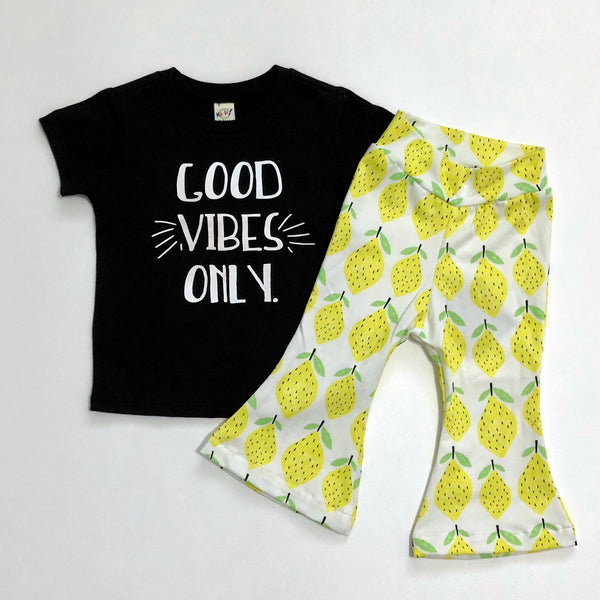 "Black Tee shirt with white lettering, ""Good Vibes Only"" and Lemon Bell Bottoms"