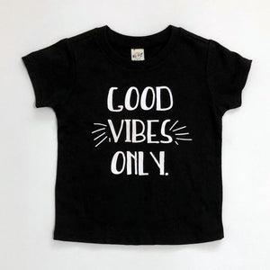 "Black Tee shirt with white lettering, ""Good Vibes Only"""