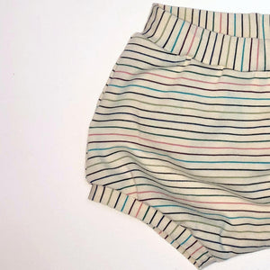 multicolored striped shorts on white fabric