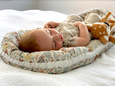 Organic baby nest cover - Blommig