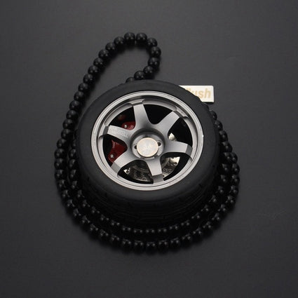 Black wheel with black chain pendant