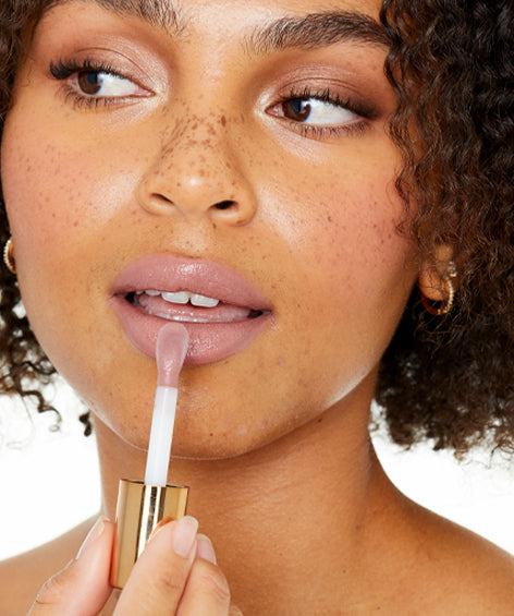 Lovingly Lip Lifestyle Image Woman Applying Makeup