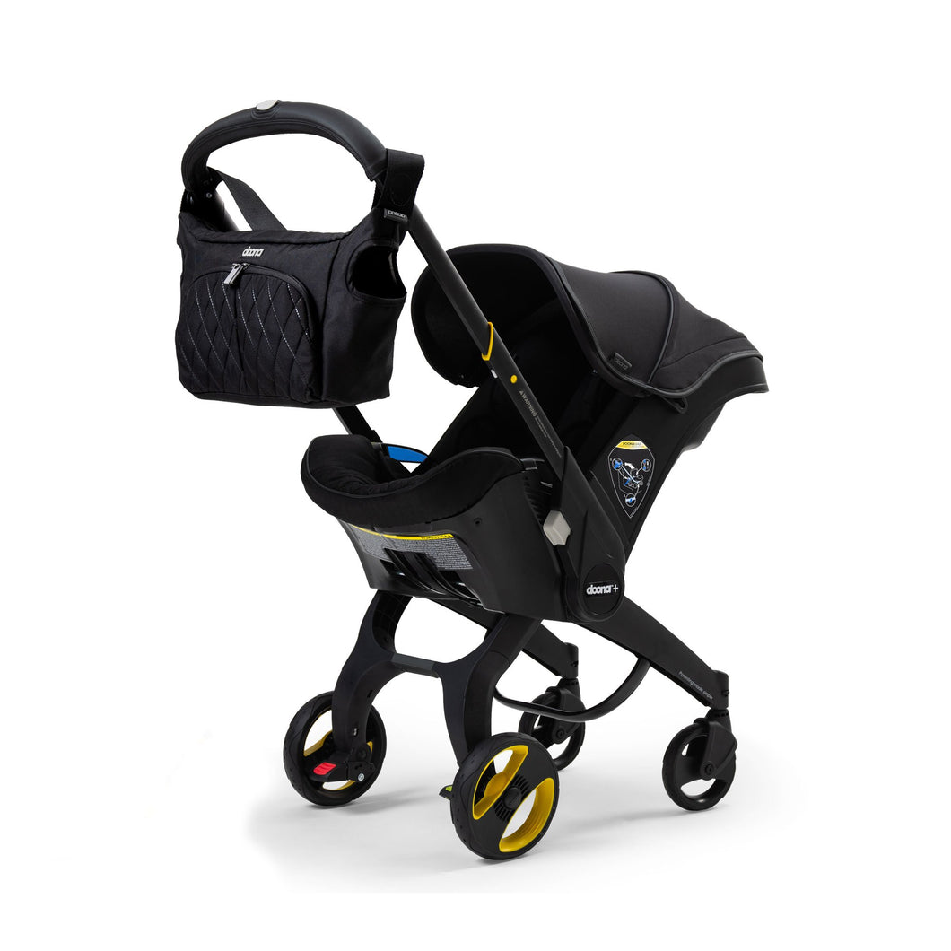 Doona Midnight Edition Infant Car Seat Stroller - Includes Base, Essentials Bag & Vehicle Seat Protector