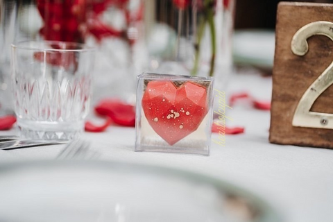 Our Mini hearts make excellent chocolate wedding favours. Here it is depicted on a wedding table setup.