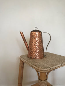 Beaten copper watering can