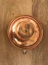 Copper candlestick with hoop handle