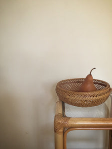 Intricately woven round cane basket