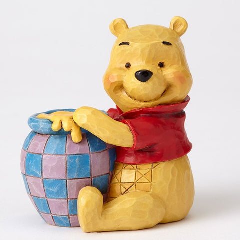 Winnie the Pooh with honey pot