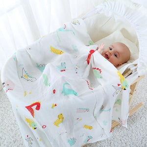 Little Dinosaur Muslin Swaddle - Our Baby Nursery