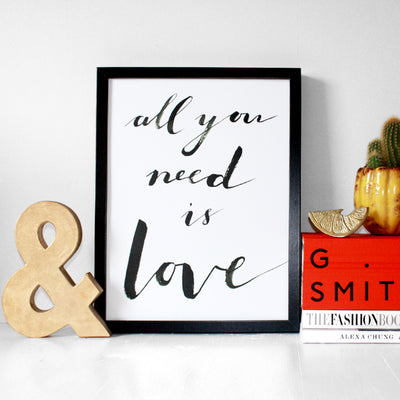 Eleanor Bowmer all you need is love white print with black handwriting font