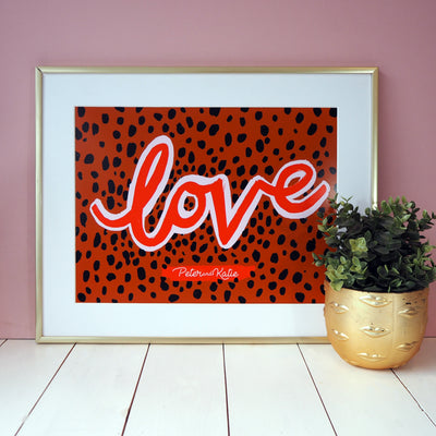 The word LOVE is written in our favourite colour combination of pink and red with a gorgeous black spot and brown leopard background personalised print.