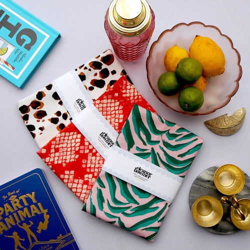 Eleanor Bowmer Tea Towels collection in red snake, Dalmatian print and pink and green zebra print.