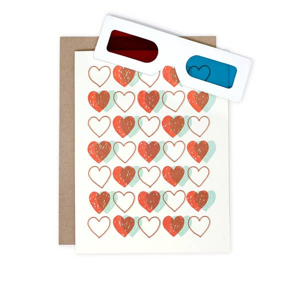 greeting card with hearts on the front printed in blue and red ink, 3-D glasses