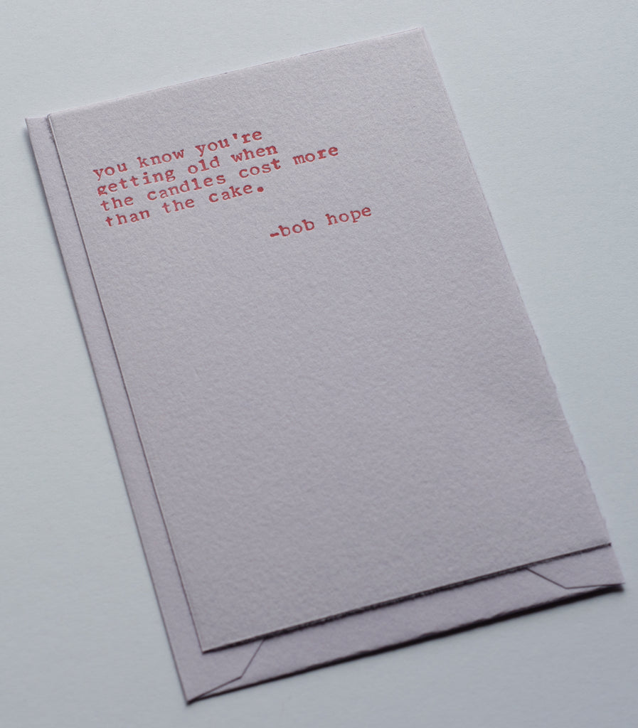 lavender card with Bob Hope quote typed with typewriter in red ink