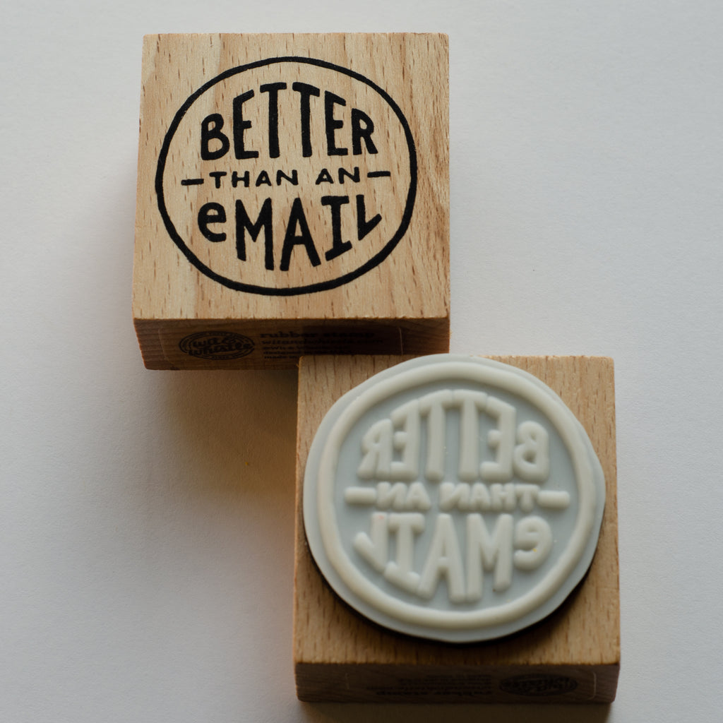 Front and back of square rubber wood stamp