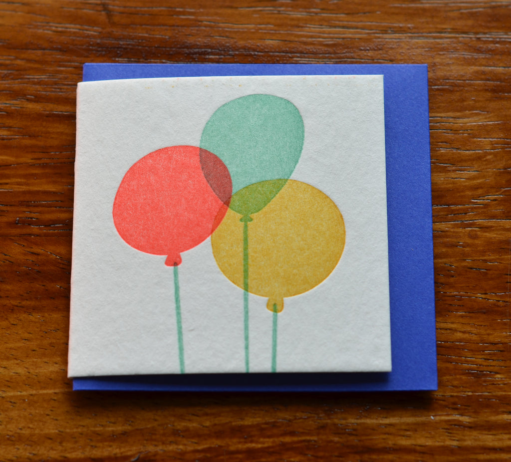 Cream card with neon balloons