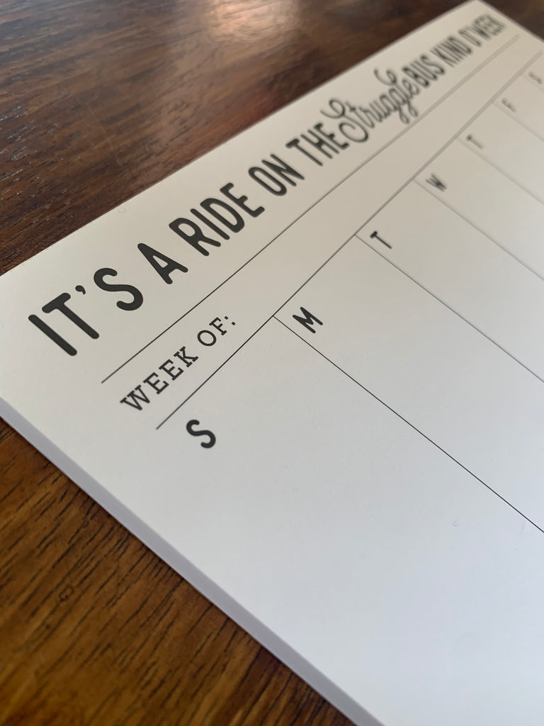 white calendar notepad with black writing
