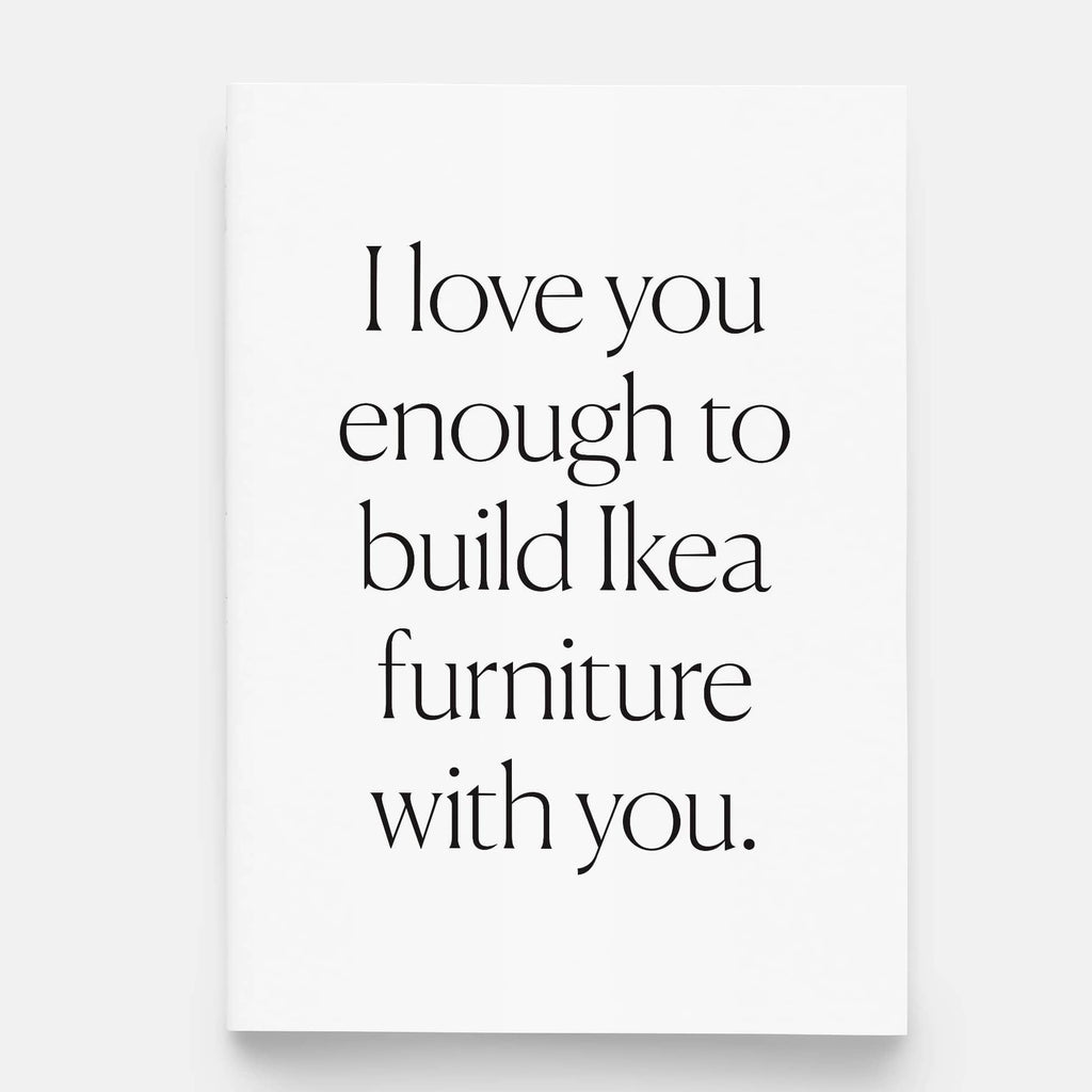 White greeting card with black lettering that says I love you enough to build Ikea furniture with you