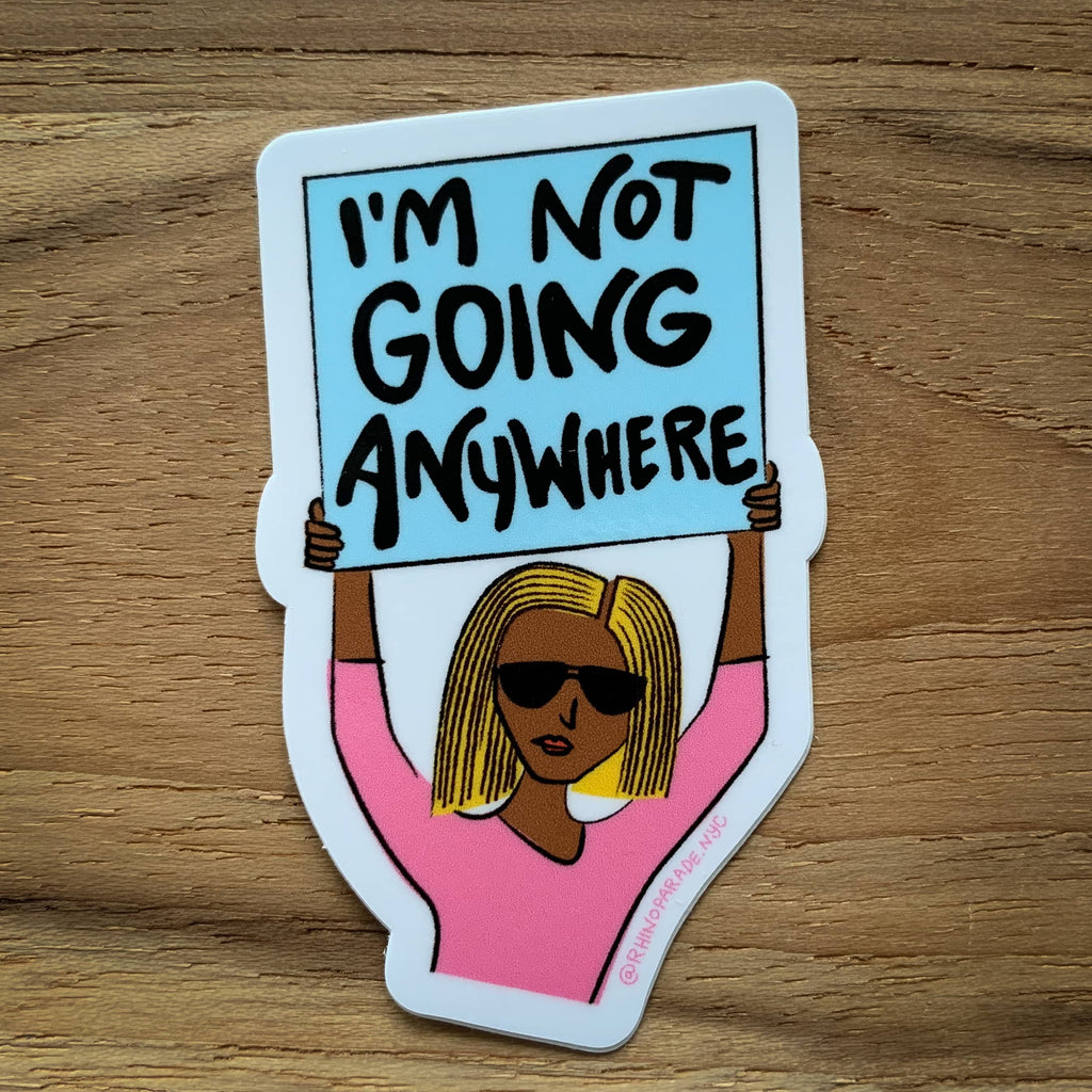 Vinyl sticker with illustrated woman in pink shirt holding sign that says I'm not going anywhere