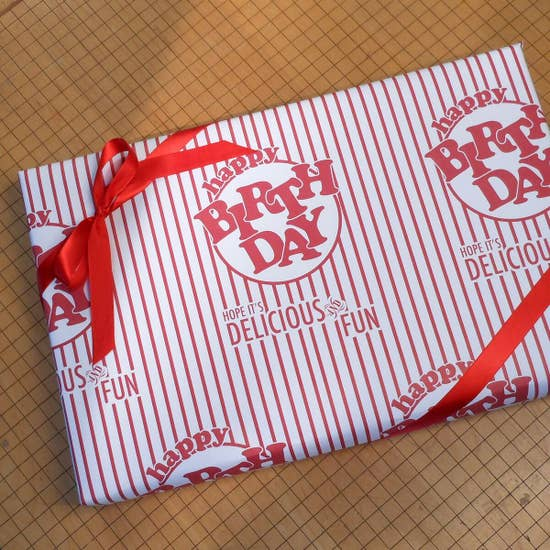 birthday gift wrapped in paper that looks like vintage popcorn box