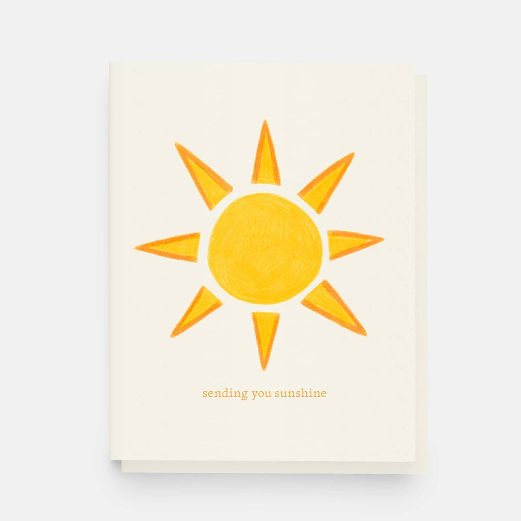 Greeting card with vibrant illustrated sunshine text reads sending you sunshine