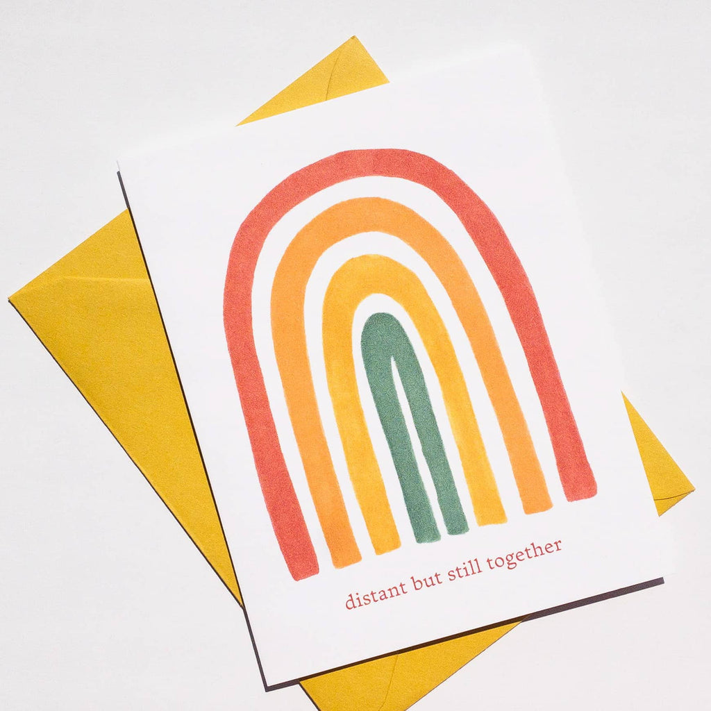 greeting card with rainbow and distant but still together text