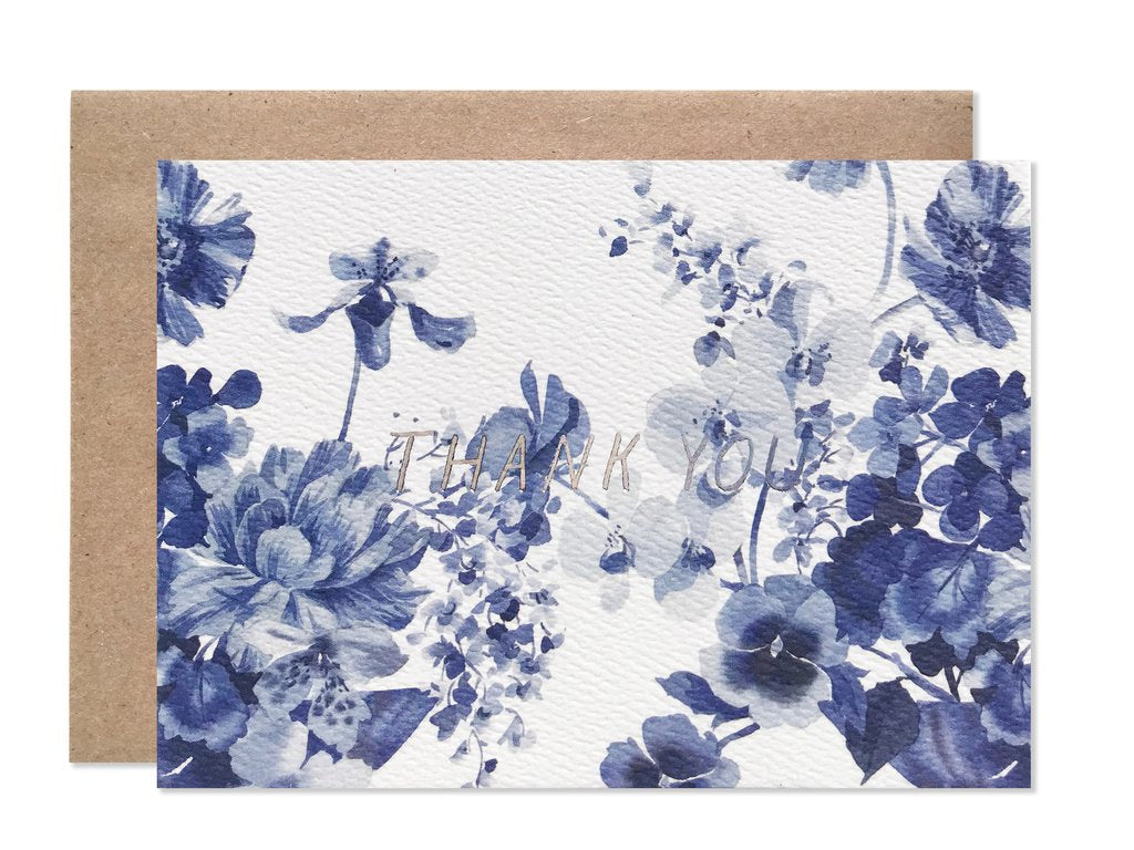 Thank you card with white background silver writing and variety of blue flowers
