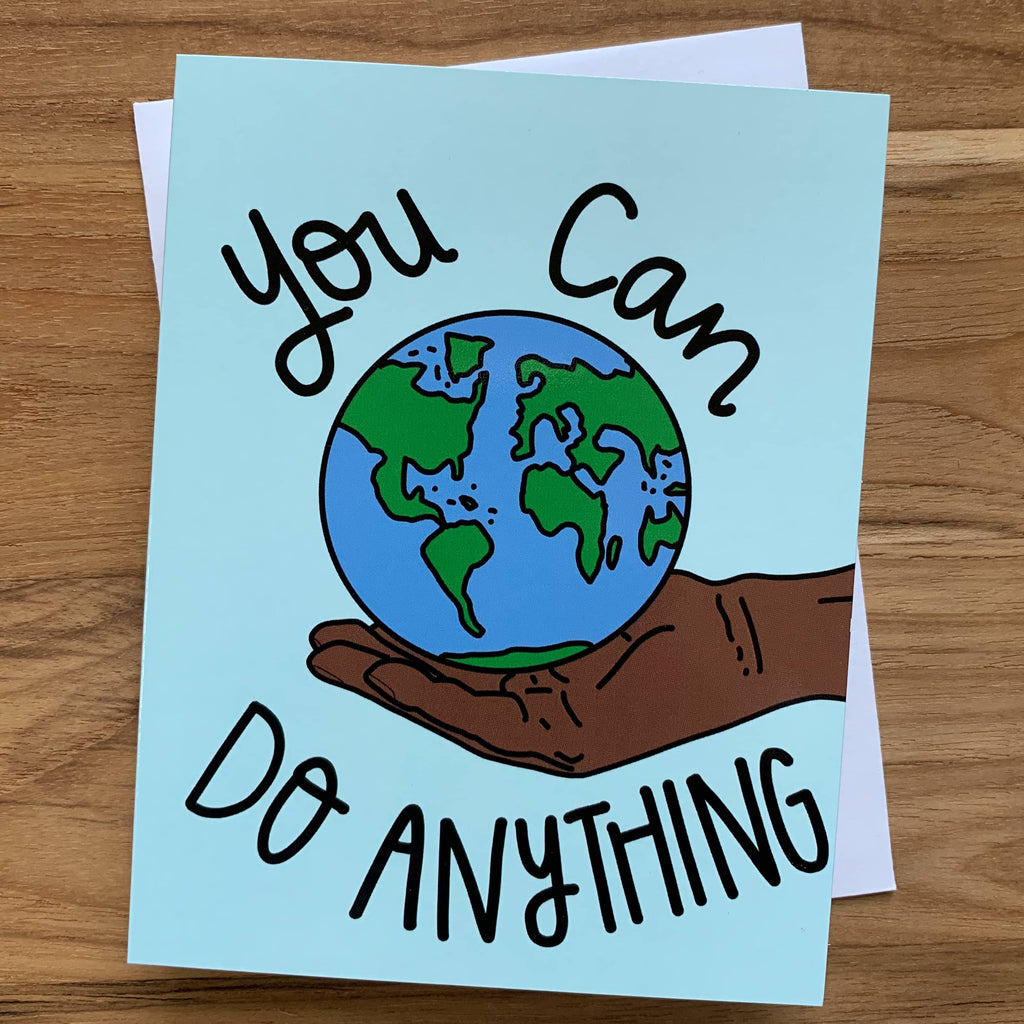 You Can Do Anything Card featuring a dark brown hand holding the world