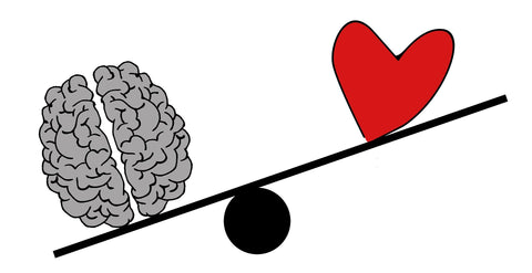 An image of a cartoon brain and heart on a scale, symbolising anxiety.