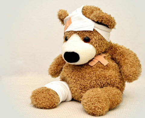 Image of a stuffed bear with bandages.