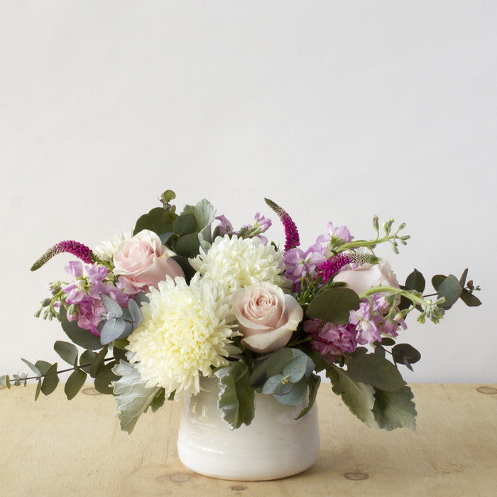 Photo of Blaisdell flower arrangement in white ceramic Tegan pot