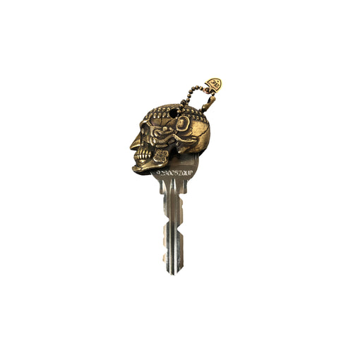 AXELCROSS / TIBETAN SKULL-BELL KEY COVER (BRASS)