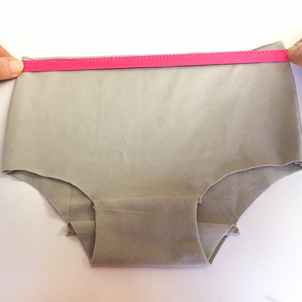 Stretching the waistband elastic to check tension