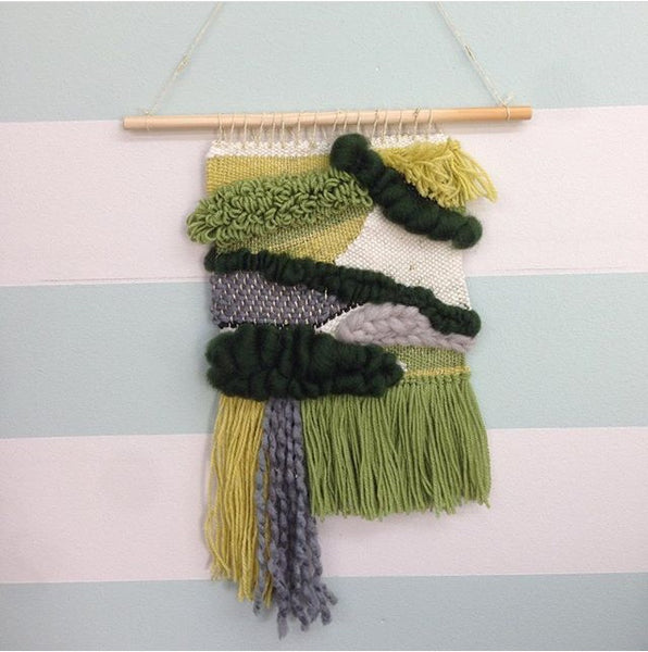 green and cream woven wall hanging