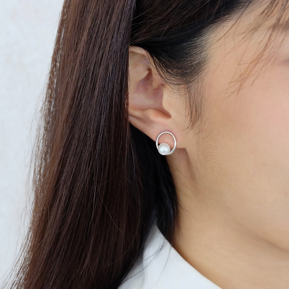 Saturn Pearl Stud Earrings