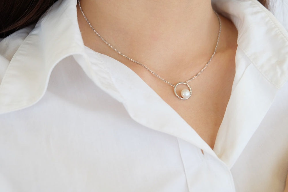 Saturn Pearl Necklace