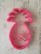 Pineapple with heart glasses