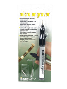 Micro engraver , includes two round -tip bits & a hex key . SKU# MCRI