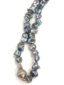 Tahitian Keshi strand with sterling silver ball clasp , SKU# 070712