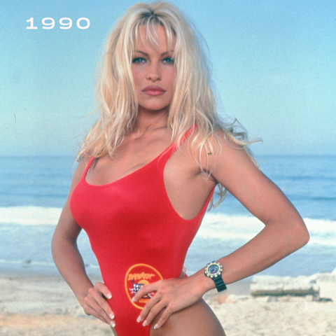 blonde women at the beach in summer with red swimsuit