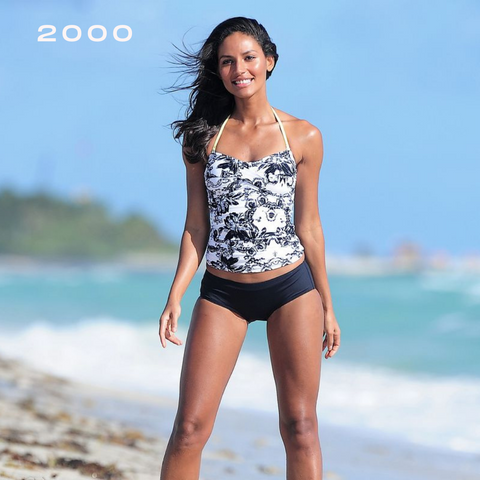 brunette woman at the beach in summer wearing tankini