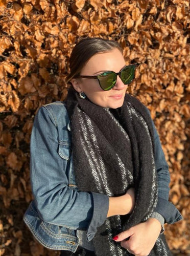 woman in full tinted mirror sunglasses on autumn day with scarf