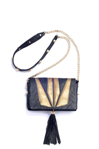 Little Bag of Joy, gold on black with studs by Riina Põldroos