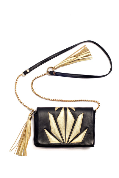 Little Bag of Joy, gold on black by Riina Põldroos