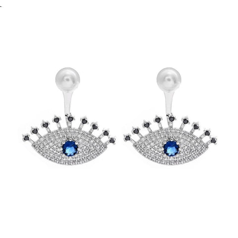 Stud Earrings with long eye lashes and pearl.