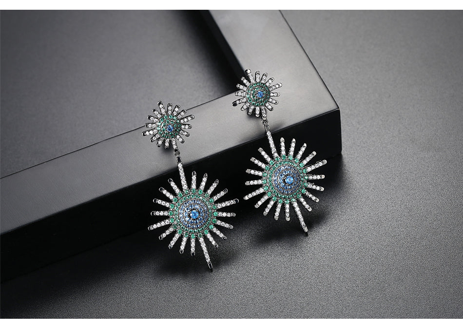 Stud and drop earrings with blue green and white 3A CZ. Top make that lasts.