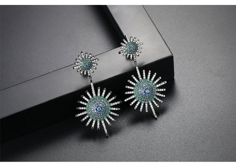 Stud and drop earrings blue green and white